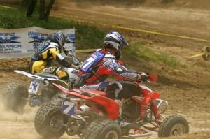 Ellis sneaks past Byrd in moto one.