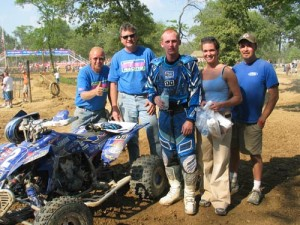 photo by Jorge Cuartas No yellow here - just Yamaha blue. Left to right is some of the MVPs behind Jeremiah Jones; Jim Jones, Curtis Sparks, Jeremiah, Jamie Rentz and James Perry (JPMX).