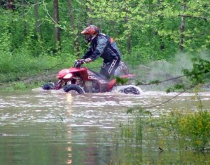 No, this isn't the river, this rider is just heading back to his pits. Many of the pitting areas became flooded after the down fall of rain Friday night.
