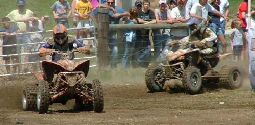 On lap three, Bryan Cook and Santo DeRisi were still fighting wheel to wheel; two boys from the same hometown, kicking up dust for the TN crowd.