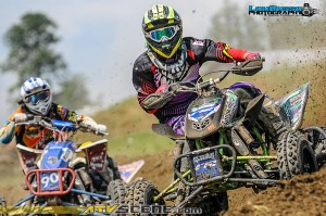 Preston Young and Cody Paolello battle in the turn at Twister Valley Mx